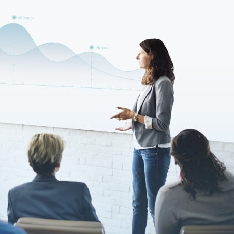 Businesswoman summarizing work in a meeting