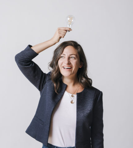 Woman holding a light bulb